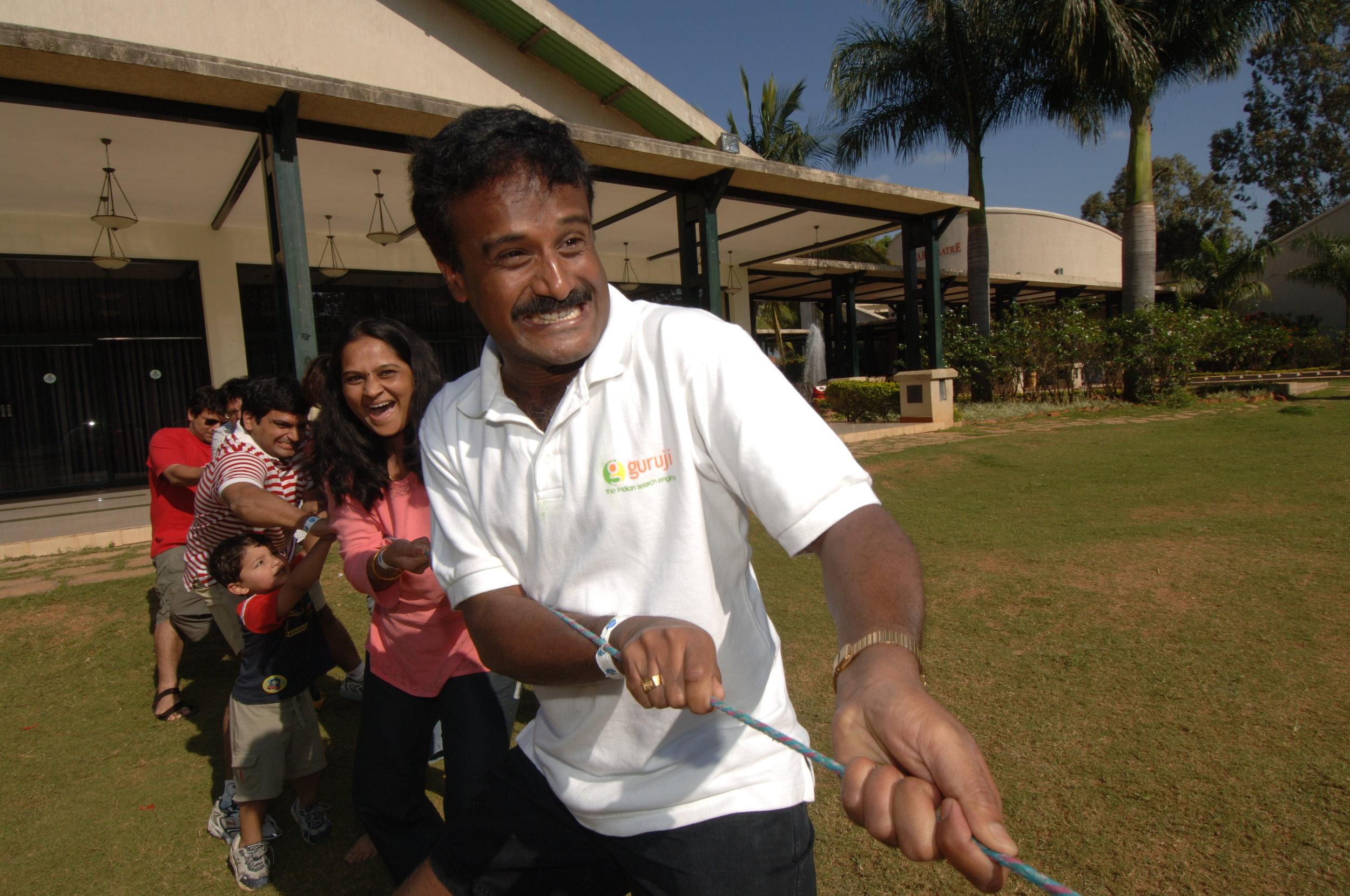 Guruji employees enjoying a game of 'tug of war' at play day at Club Cabana at an exclusive resort on the outskirts of Bangalore.