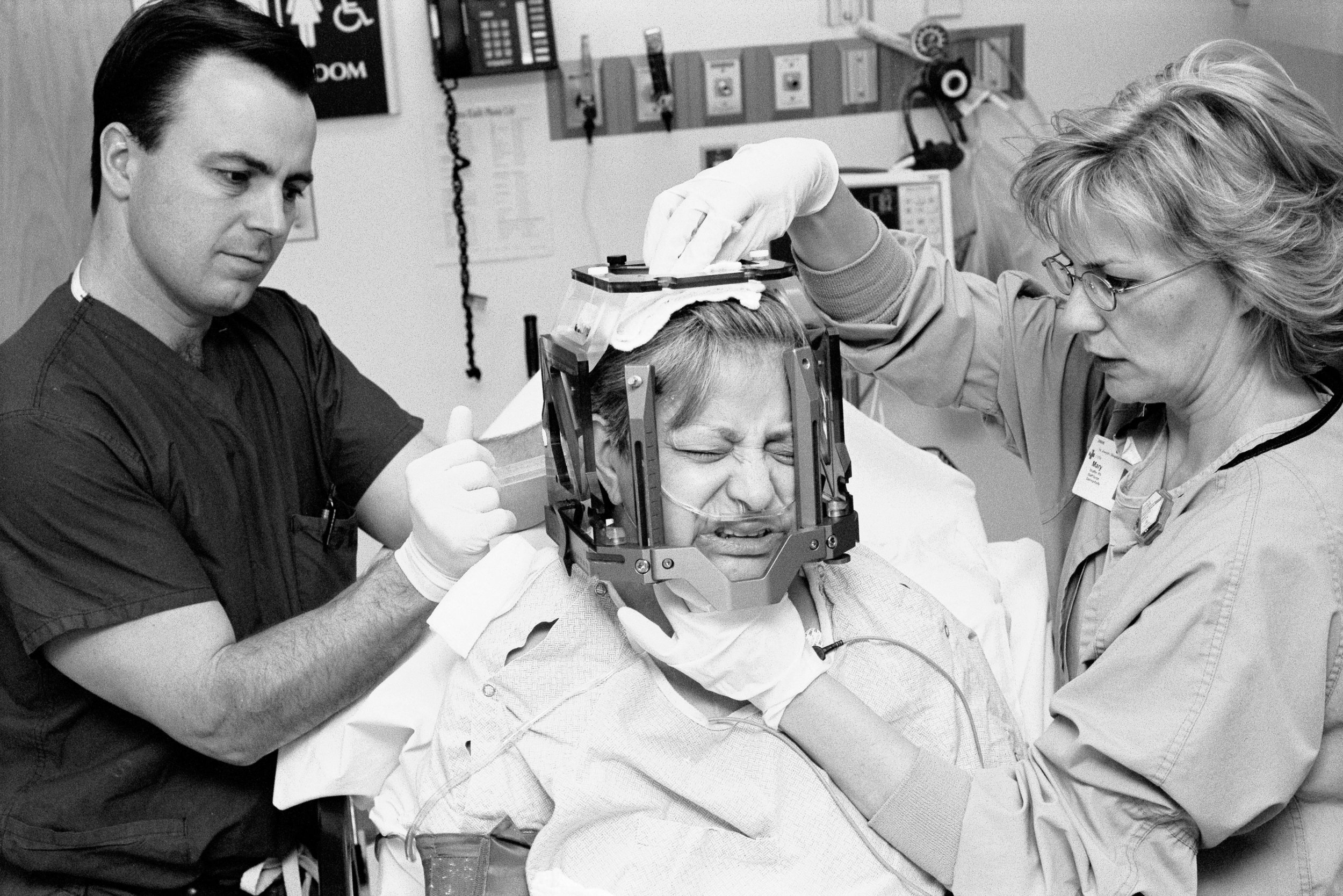 Dr. Randall Porter fixing the frame used for Gamma Knife radiation. Dr. Kris Smith, considered to have been one of Spetzler's star trainees and now a full time Physician at the BNI, performed my Gamma Knife surgery. Gamma Knife Radiation shrunk the remainder of my tumour by focusing a mass of gamma radiation onto a single spot inside the brain.