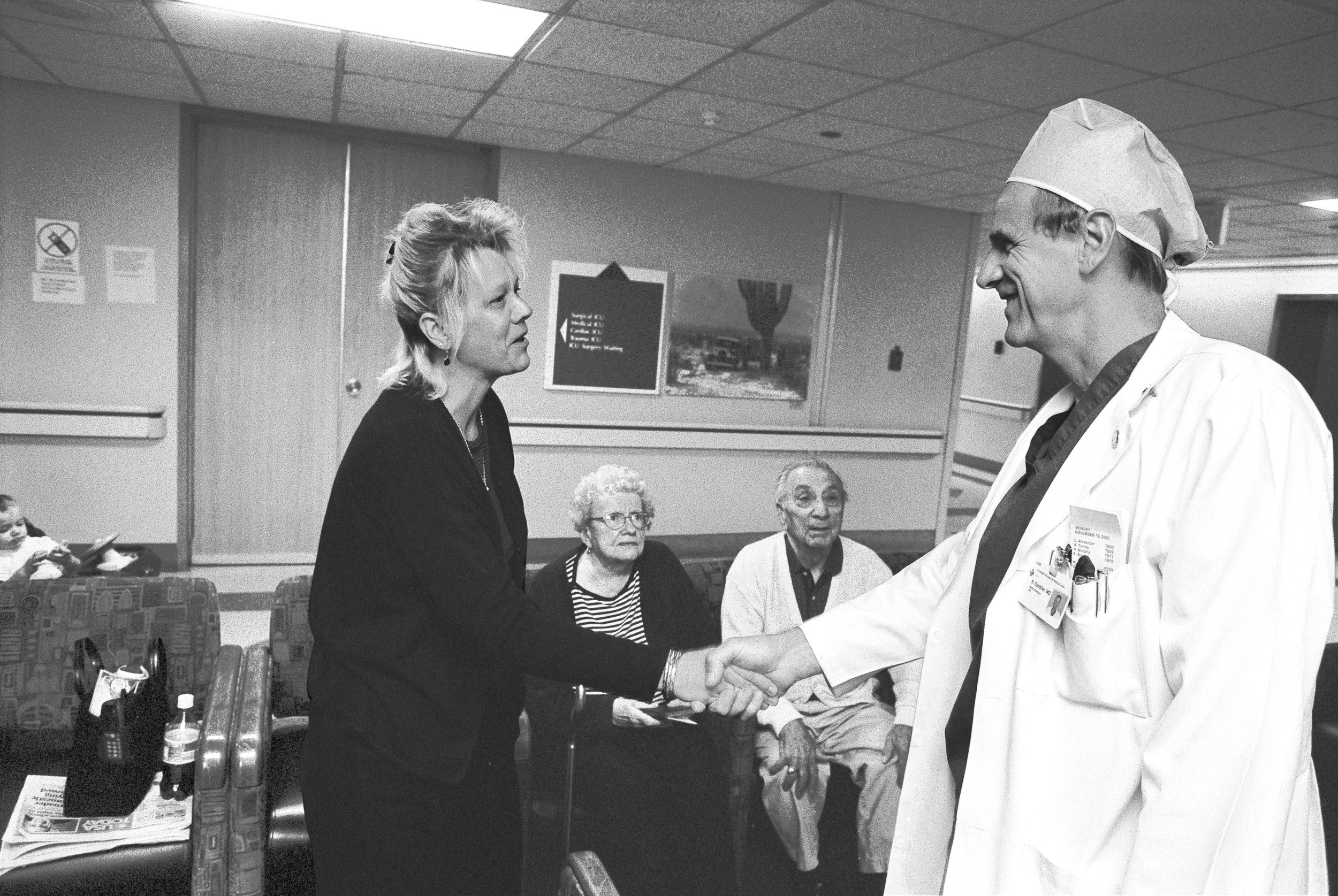 Dr. Spetzler giving the good news to the loved ones of patient on whom he has successfully operated. He had 'defused' an aneurysm buried deep within the patient's brain.