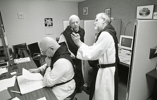 Sessions in the Computer room are one of the few times of the day that these Cistercian Monks are permitted to discuss with one another.