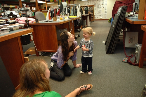 Jen Rapp playing with her daughter in Patagonia offices… her daughter attends Patagonia's in‐house crèche (Jen's husband also works at Patagonia) during weekdays… meaning that Jen and other Patagonia parents can pay regular visits to their children based next door to the office….