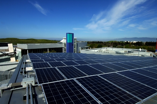 In 2007 Google installed 1.6MW solar panels at its headquarters ‐ 9,212 solar panels that cover the rooftops of eight buildings and two solar carports at the Googleplex. The cooling of Google's data centres is down thru evaporation towers instead of A/C.