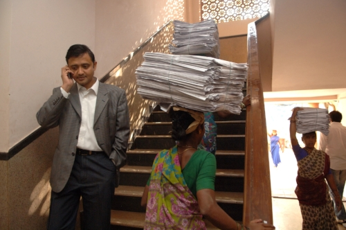 Gopal Krishnan, Mobile2Win's co-founder, walking down the stairs from M2W's offices based in an old printing press building on the Todi estate in Mumbai. GK, as he's called, thinks that the real technological revolution in India will happen not via the PC, but via the mobile phone.