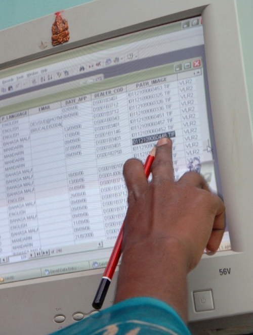 A rural-based worker performing database entry at a small entrepreneurial kiosk in the small village outside Thirivallur – 80 kms or so outside of Chennai.