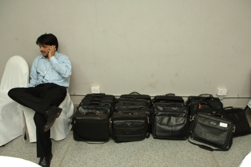 An IT worker in the Left luggage room (laptop) room at the Texas Instrument conference in Bangalore.