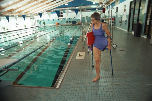 Carla Shuford about to begin her 6am daily one mile swim at her local pool in Durham, North Virginia. In 1958, aged 15, she was diagnosed with bone cancer, in her left leg, which had spread to her lymph system. The diagnosis back then was a virtual death sentence.