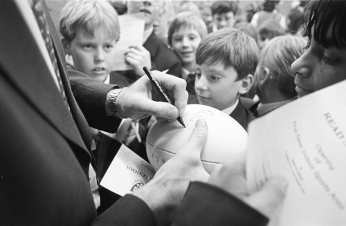 Ben Clarke played for Bath Rugby from 1992 to 1996, before joining Richmond F.C. as the first £1-million player. Seen here, signing rugby balls for kids at a neighbours power plant (he did PR work for British Gas).