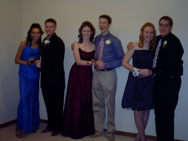 Dani and I our sophomore year homecoming, circa 2001. Dani is on the far left, and I'm on the right. Pretty sure we opted to hold hands with our dates like that all on our own. Awwwkkkwaaard.