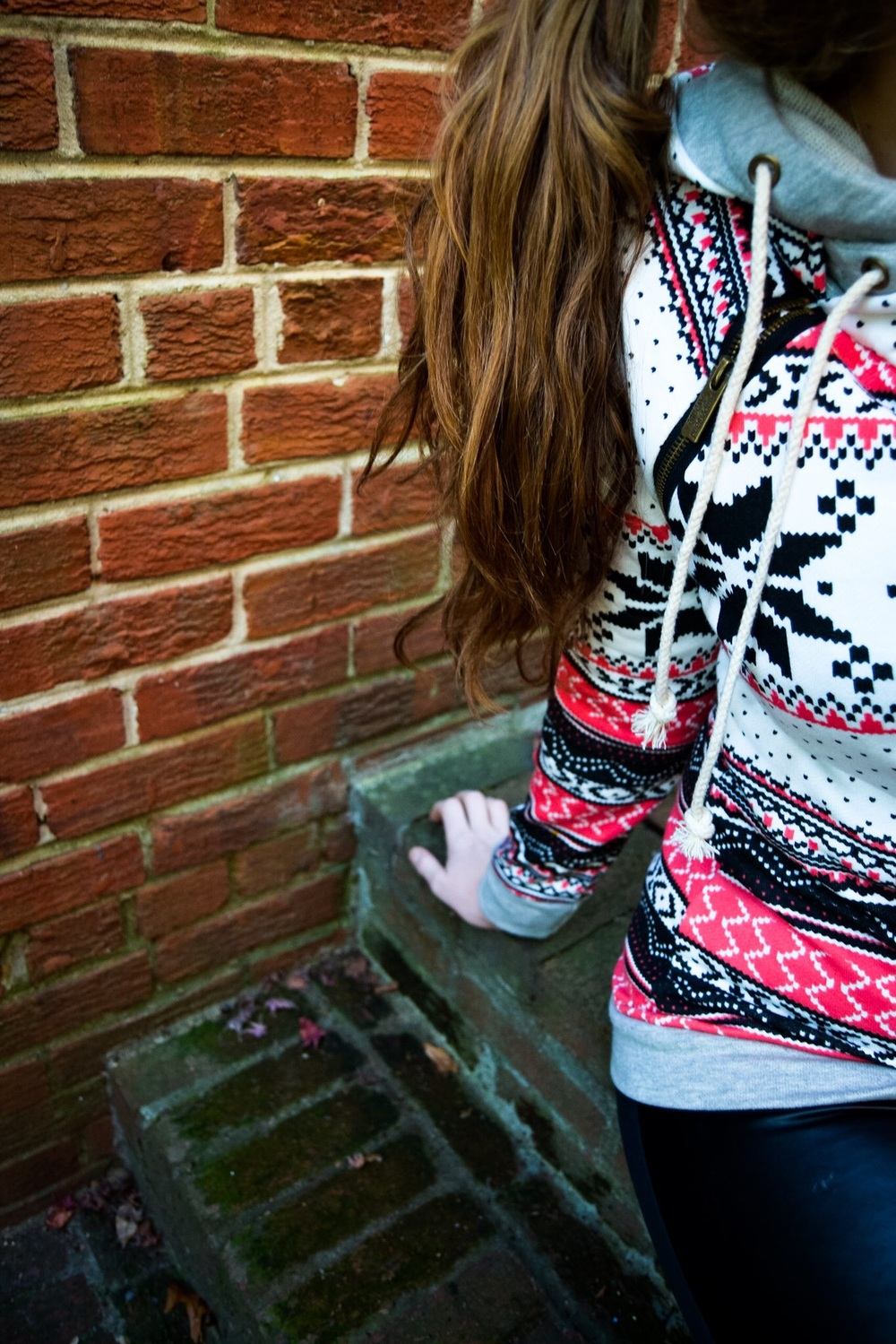 Living in this wintery printed double hoodie this winter. (Mindy Mae's Market.)
