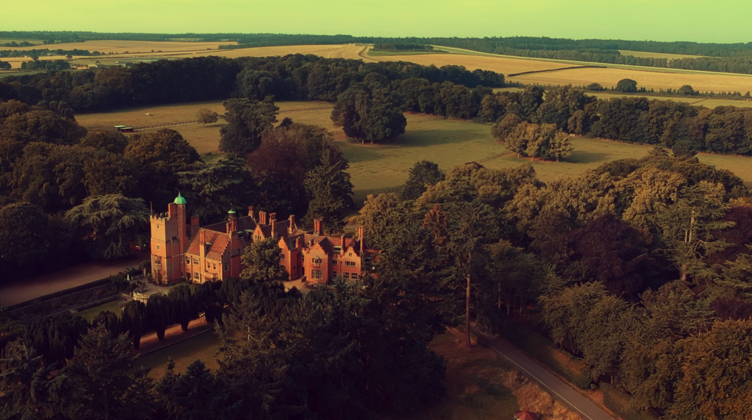 Image: Screenshot from Jenna & Jamies Wedding Film! The Race Wedding Videography drone setting the scene of this countryside location. Lanwades Hall even looks grand from a distance.