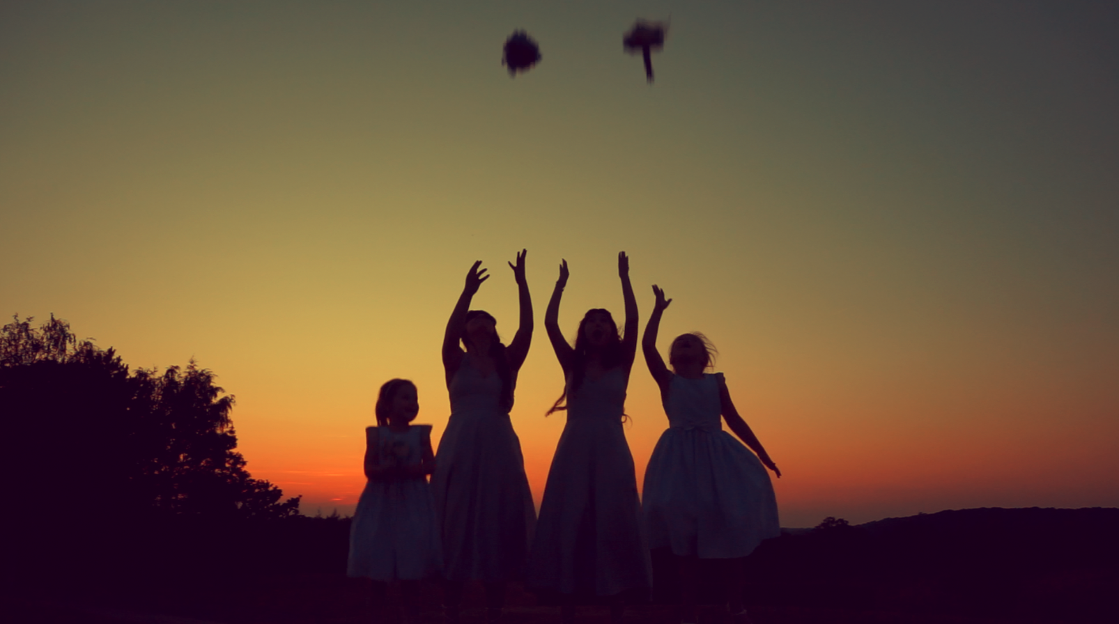 Image: The bridemaids having fun at sunset (they never did catch the boquets…)