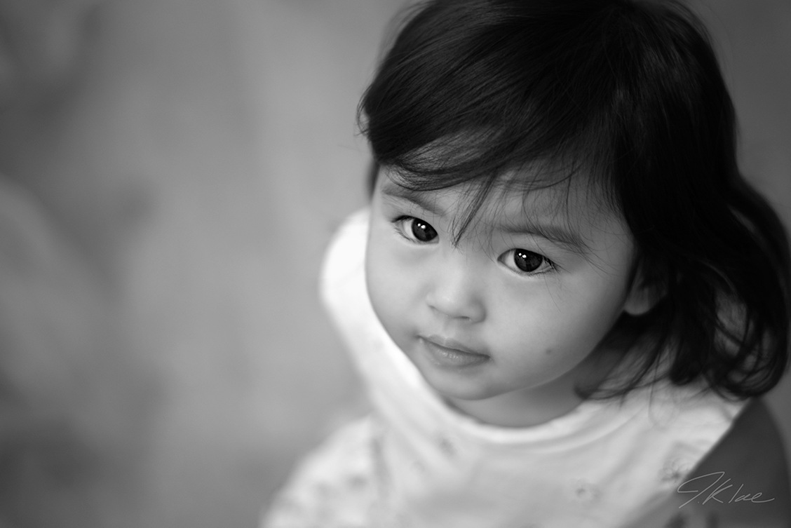 Frisco Texas Baby girl photography in black and white of flower girl looking up