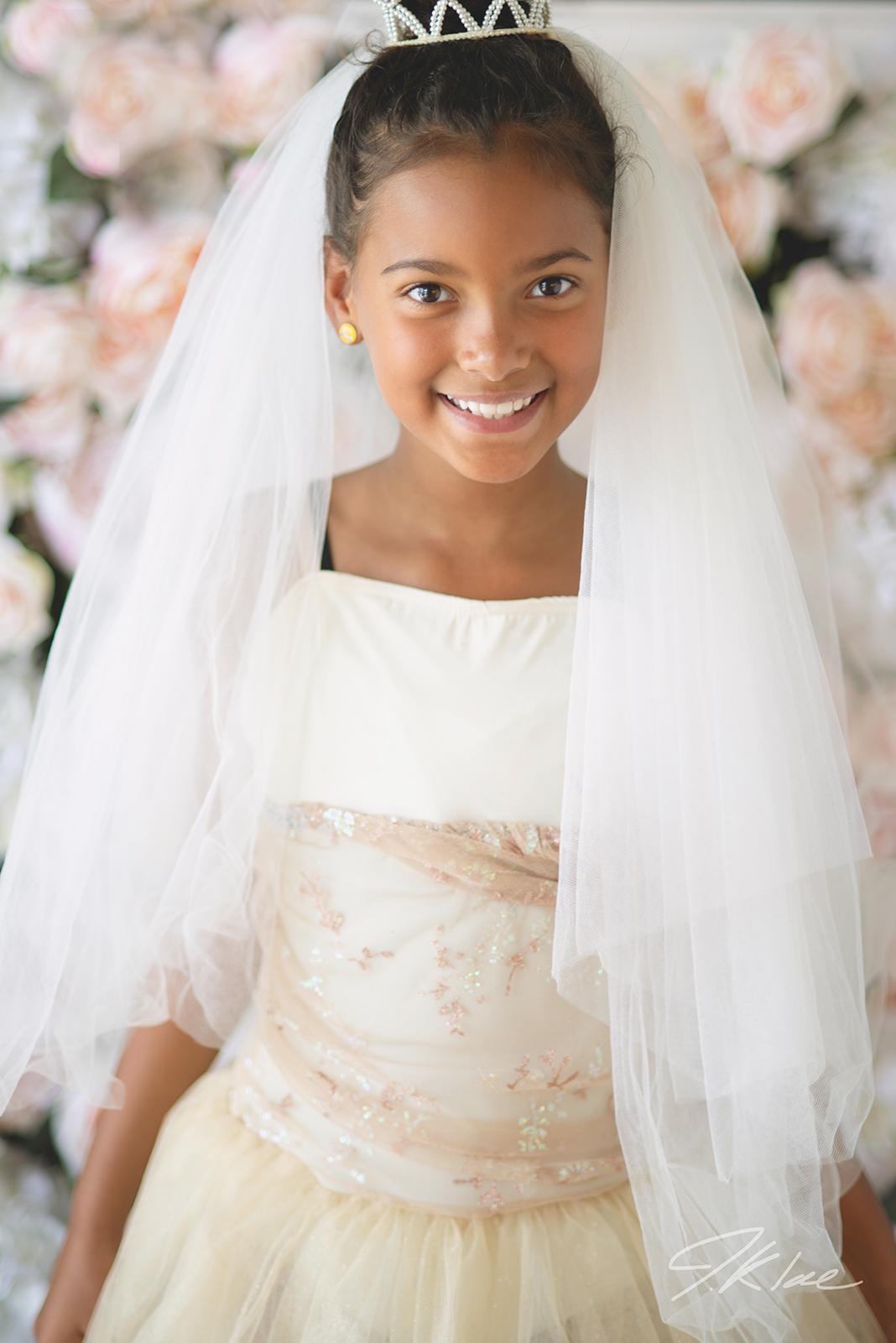 Princess images of girl with tiara, veil, and beautiful dress in Frisco Texas