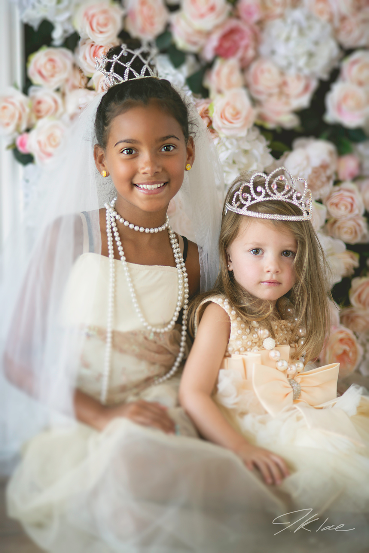 Princess Images of two girls with tiaras, veils, and beautiful dresses in Frisco Texas