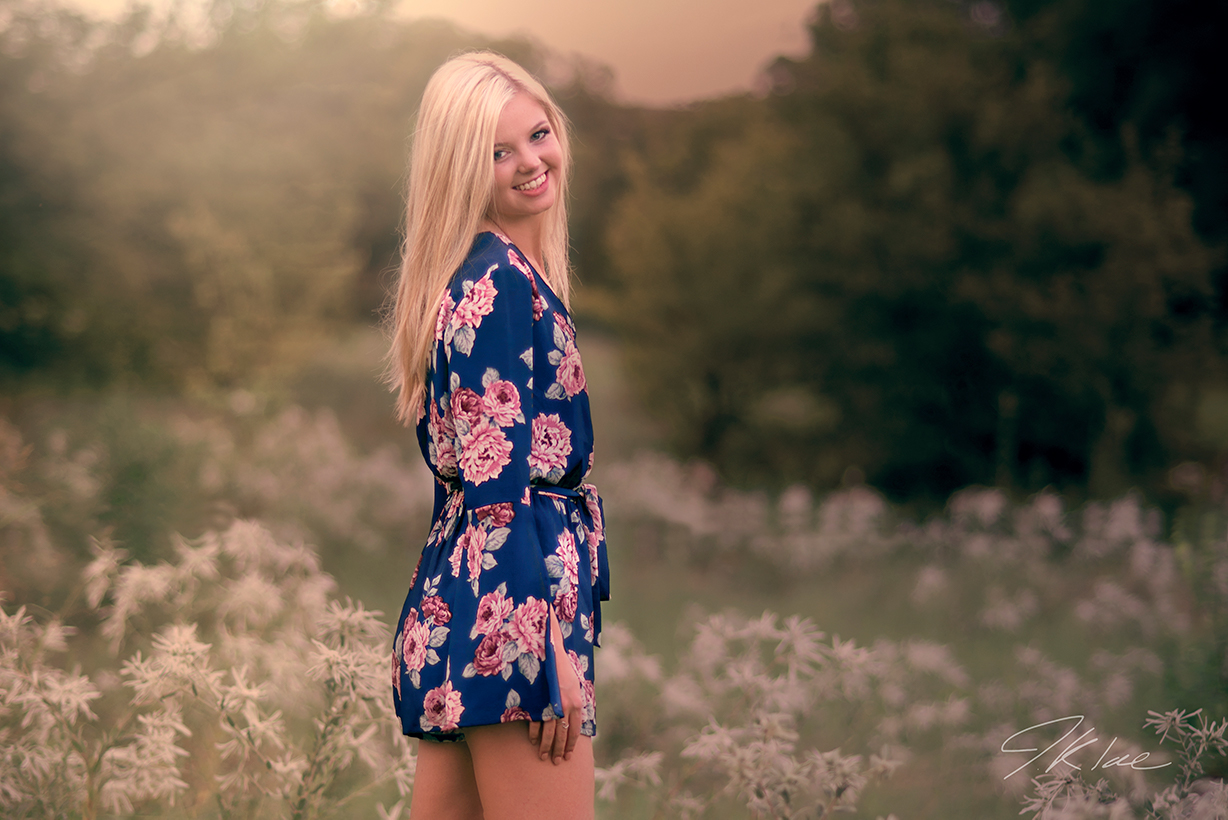 Girls Senior Portrait in a field of flower at Arbor Hills Nature Preserve in Plano Texas