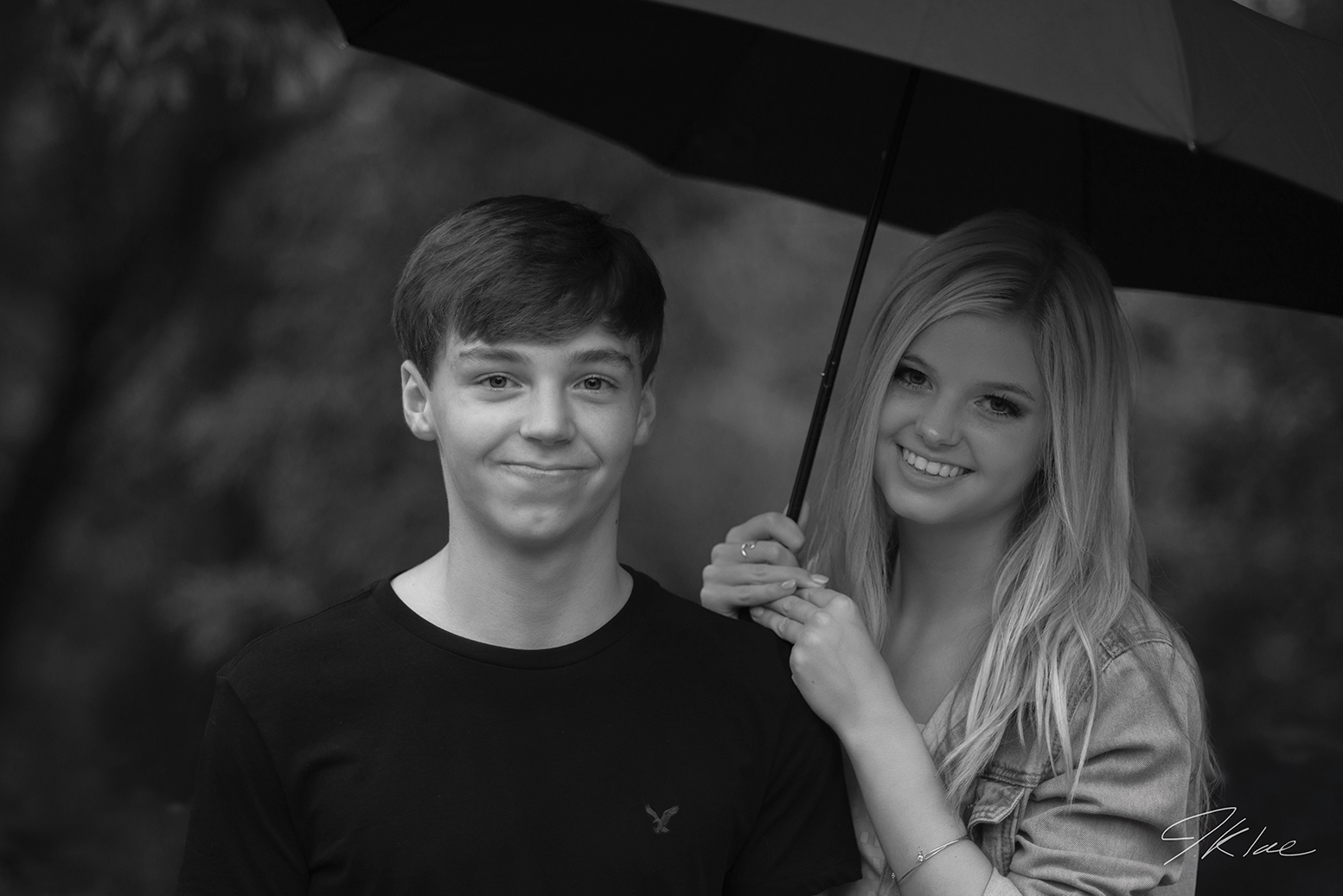 Senior Portrait of Twin Brother and Sister holding umbrella in black and white at Arbor Hills Nature Preserve in Plano Texas