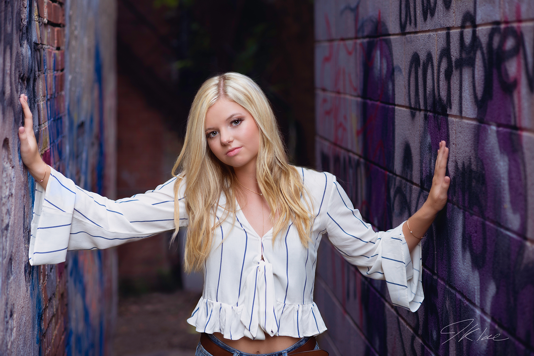 Downtown McKinney Texas Girls Senior Picture with Purple Graffiti Wall