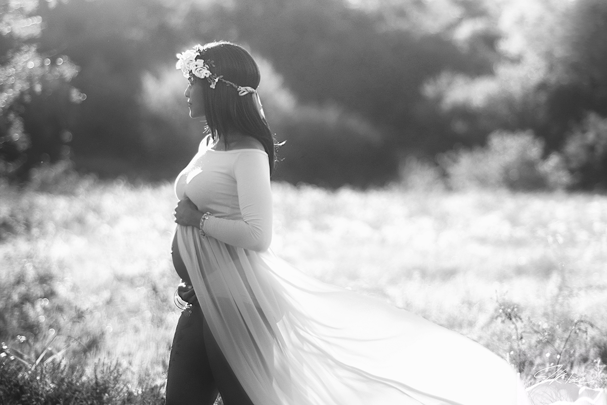 Beautiful Maternity Photograph in Black and White with long flowing Maternity Dress at Arbor Hills Nature Preserve in Plano Texas