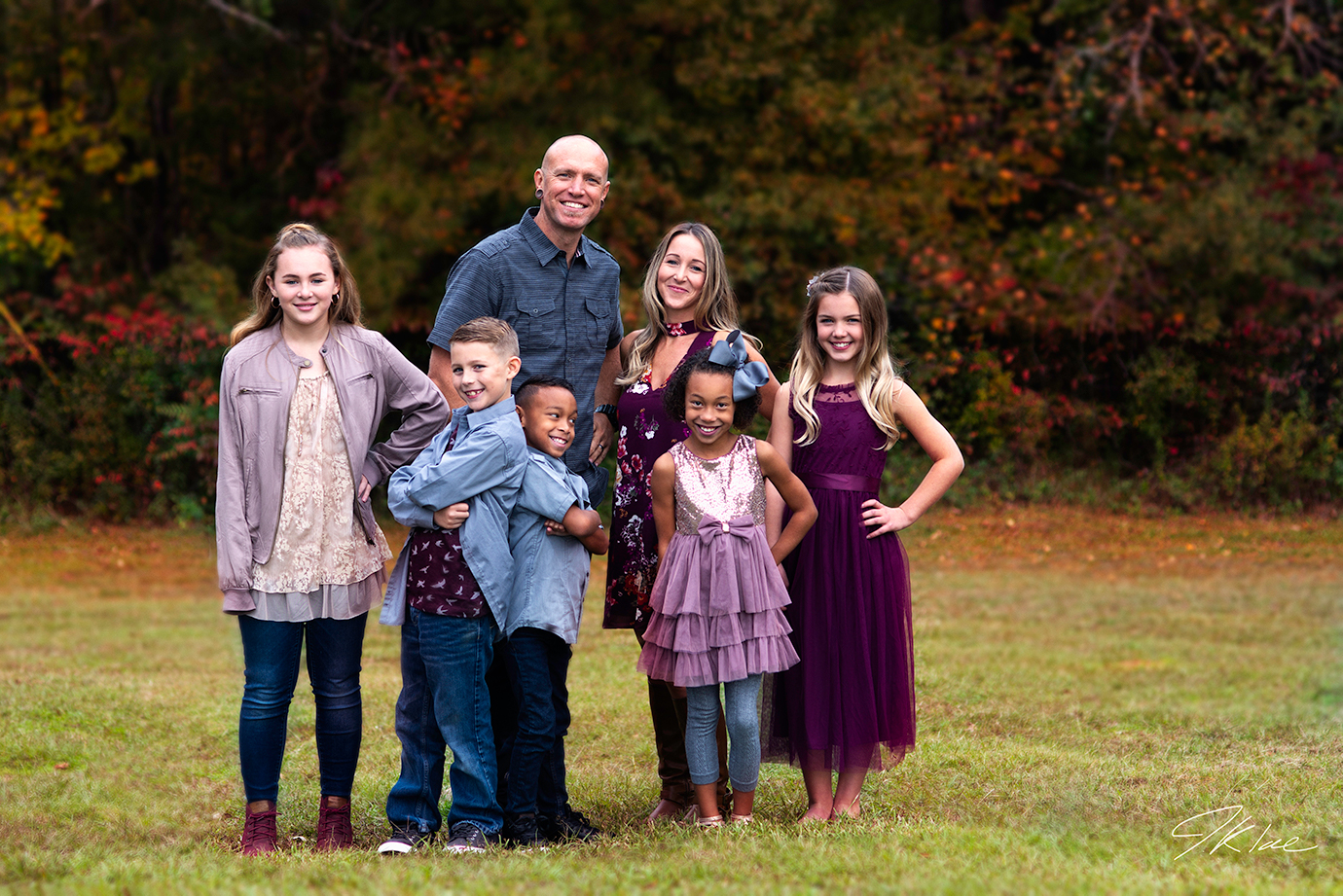 Family Portrait photographed with fall colors in Lindale Texas