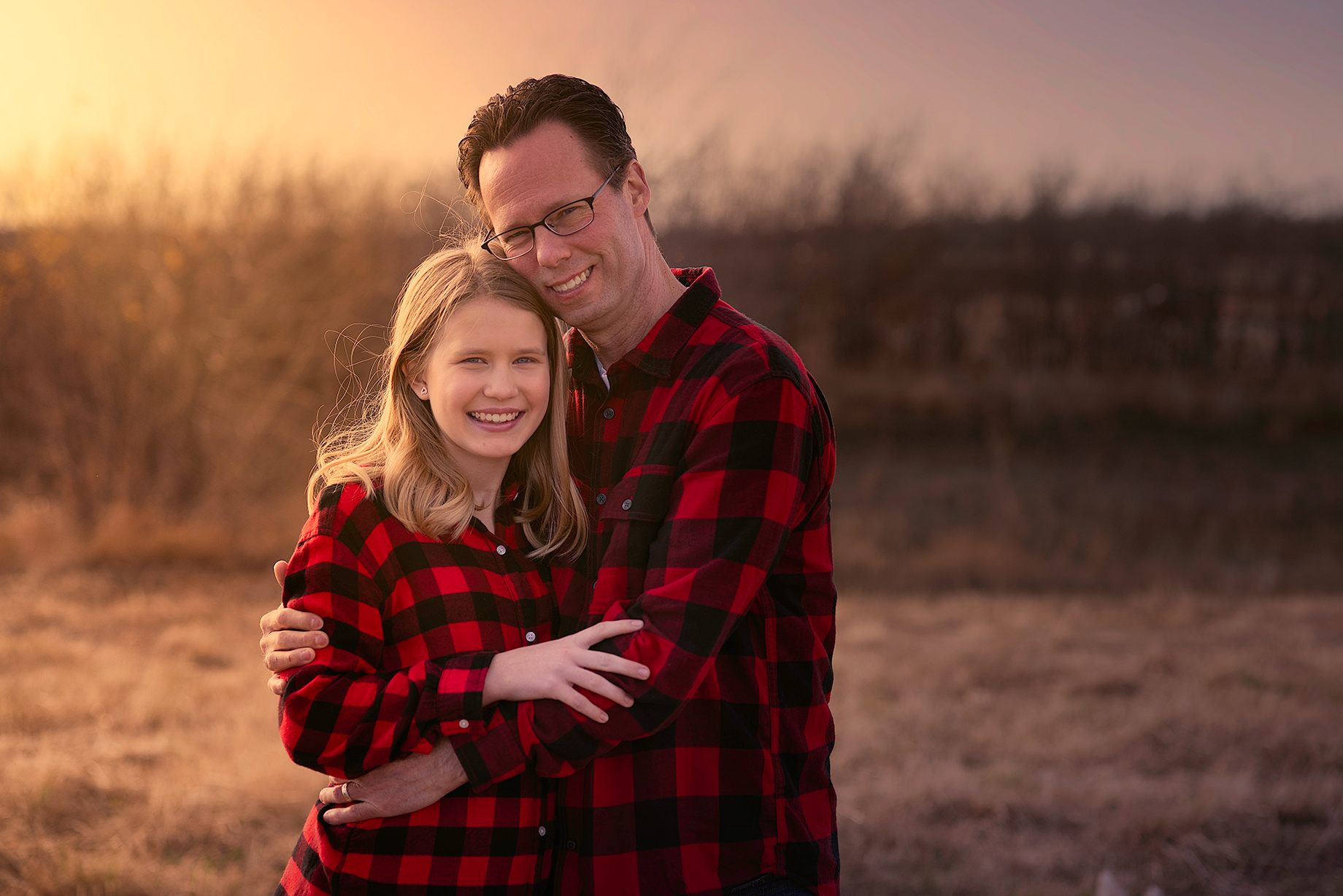 McKinney Texas Family Portrait of Father and Daughter Hugging During Sunset
