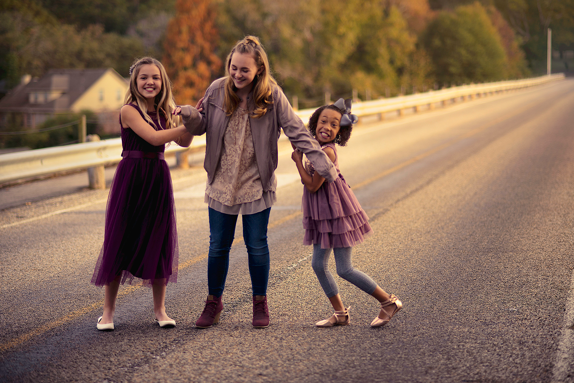 Kids Photoshoot with three sisters playing and laughing on a bridge in Lindale Texas