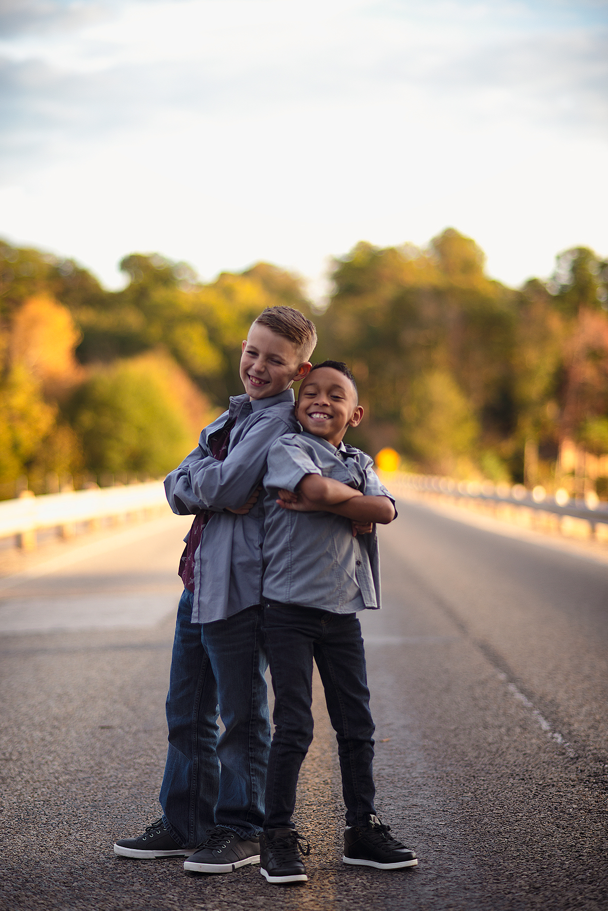 Kids Photoshoot with two brothers striking a pose on a bridge in Lindale Texas