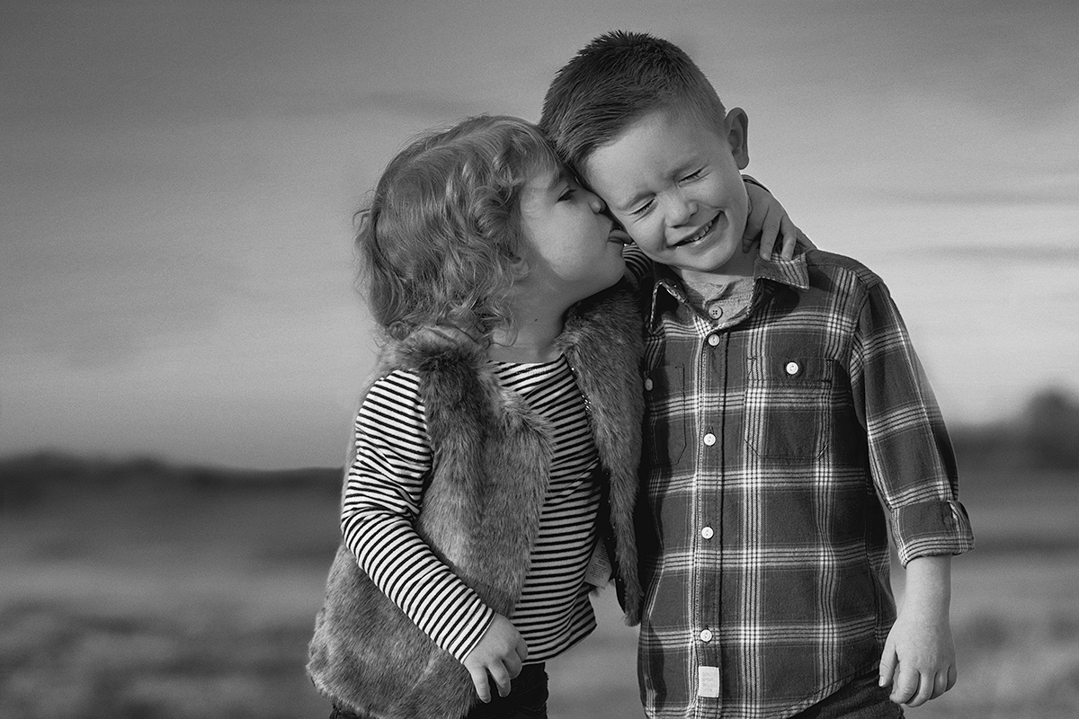 McKinney Texas Toddler Photoshoot with Sister Licking Brothers cheek
