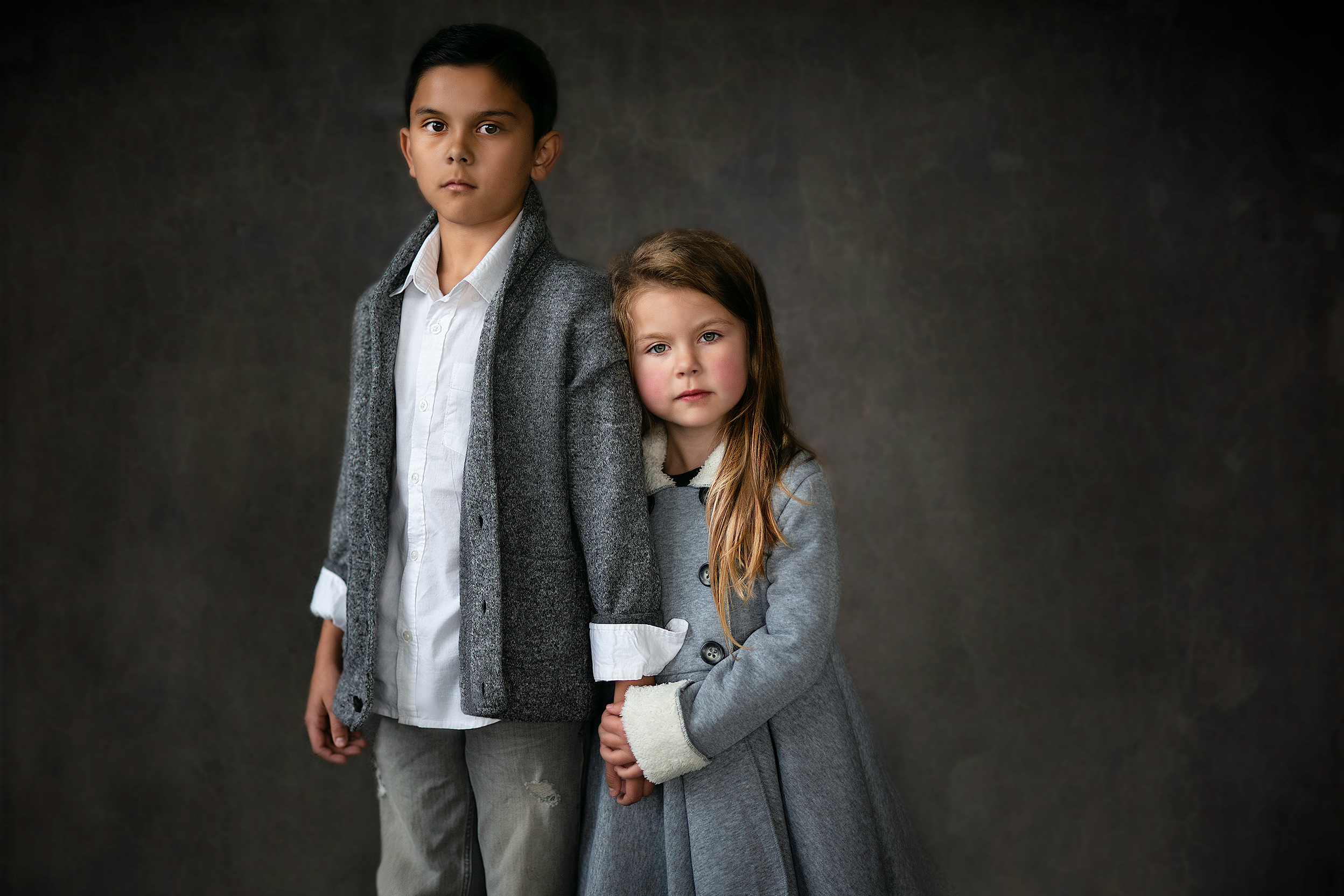 Fashion Fine Art Children's Portraiture of Brother and Sister holding hands in Studio