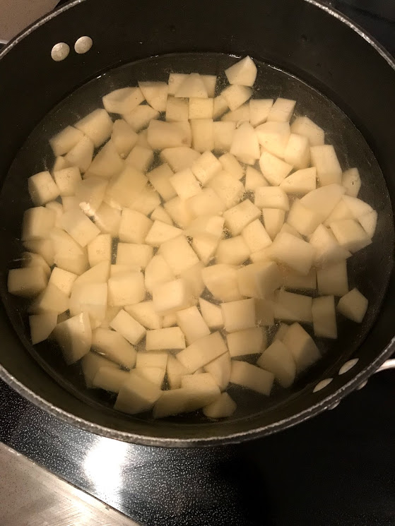 Get your taters boiling. Make sure you check on them, you want them to be cooked through but not falling apart.