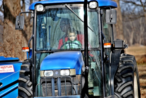 Uncle Terry and grandson Ruger helping to clean-up harvest this spring.