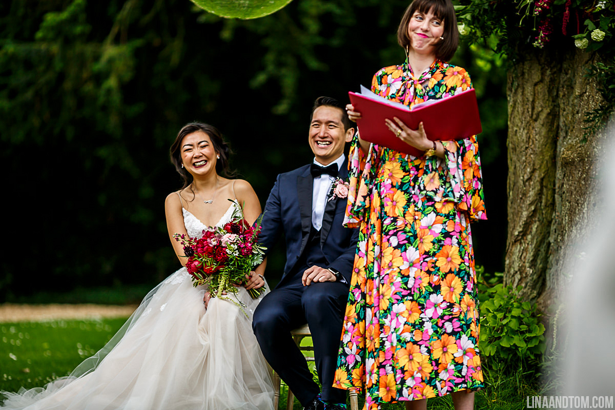 Kim and Ho's bonkers outdoor humanist wedding (complete with Tequila shots, mid ceremony) at the fabulous Aynhoe Park. Image by  Lina & Tom .