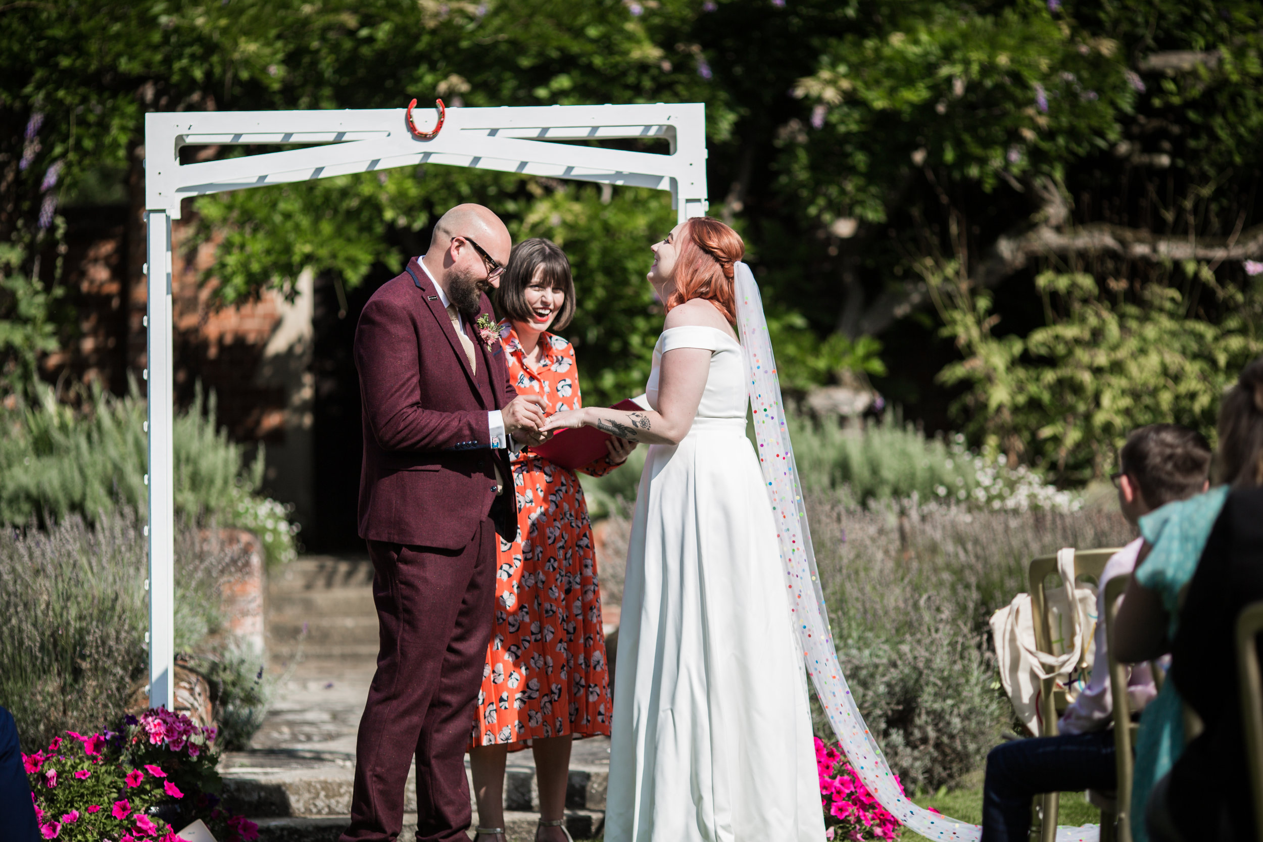 Amanda and Matt's outdoor humanist wedding ceremony at Lanwades Hall, Newmarket. Image by  Him and Her Photography.