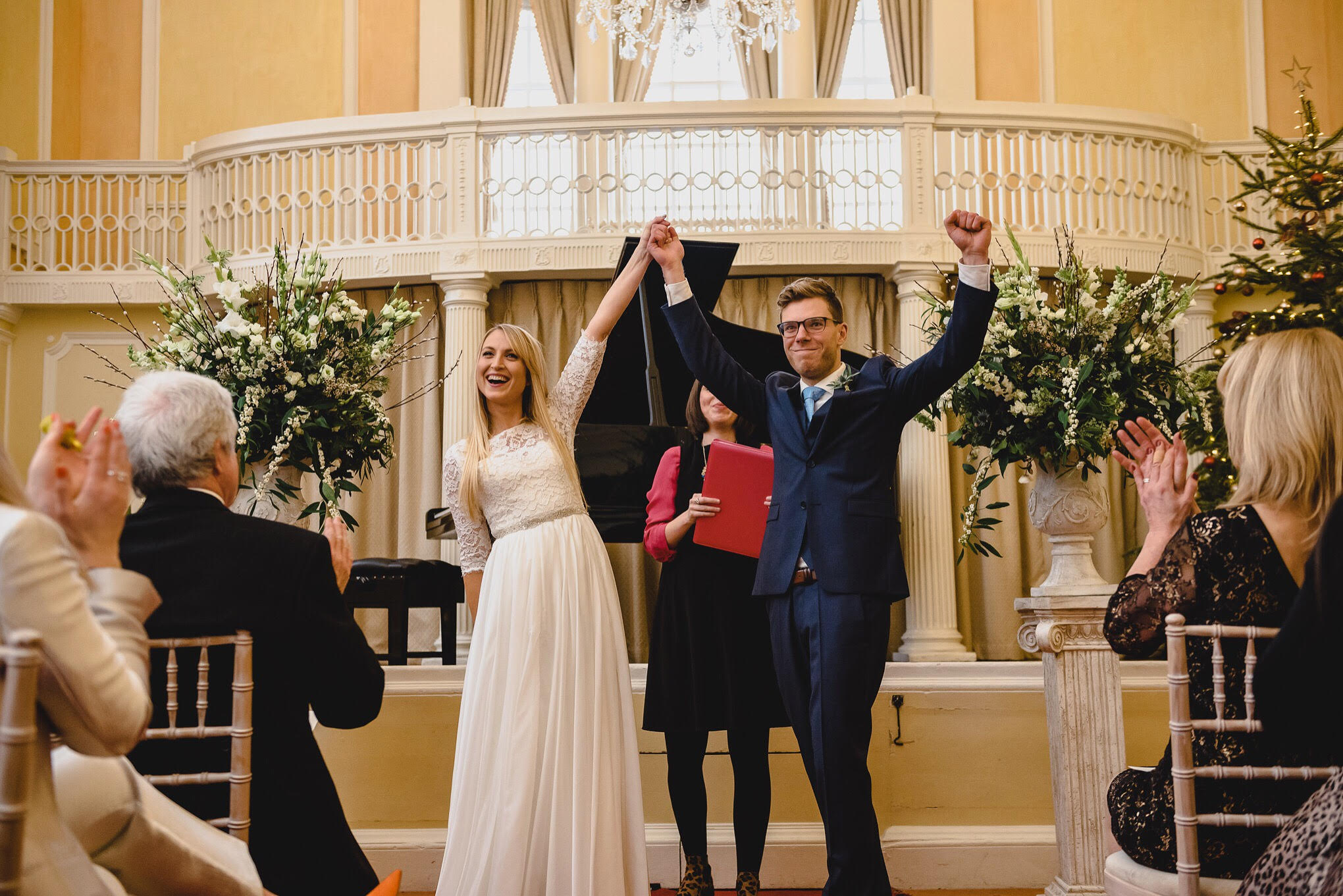 Lucy and Joe - looking very married with their triumphant power posing! Image by  Beth Moseley Photography
