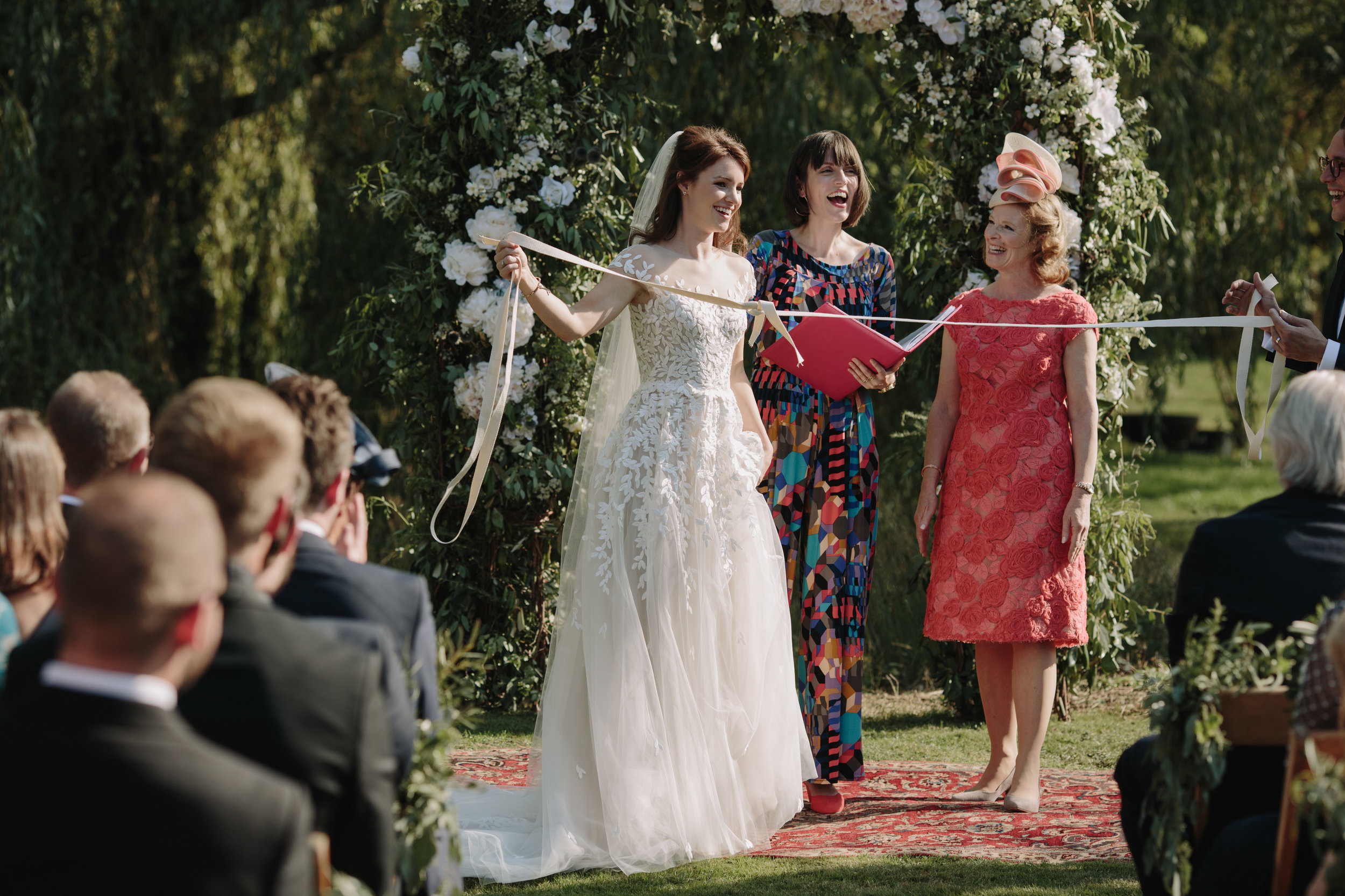 Phoebe and Ollie literally tying the knot in their humanist hand fasting ceremony! Image   by   Emilie White