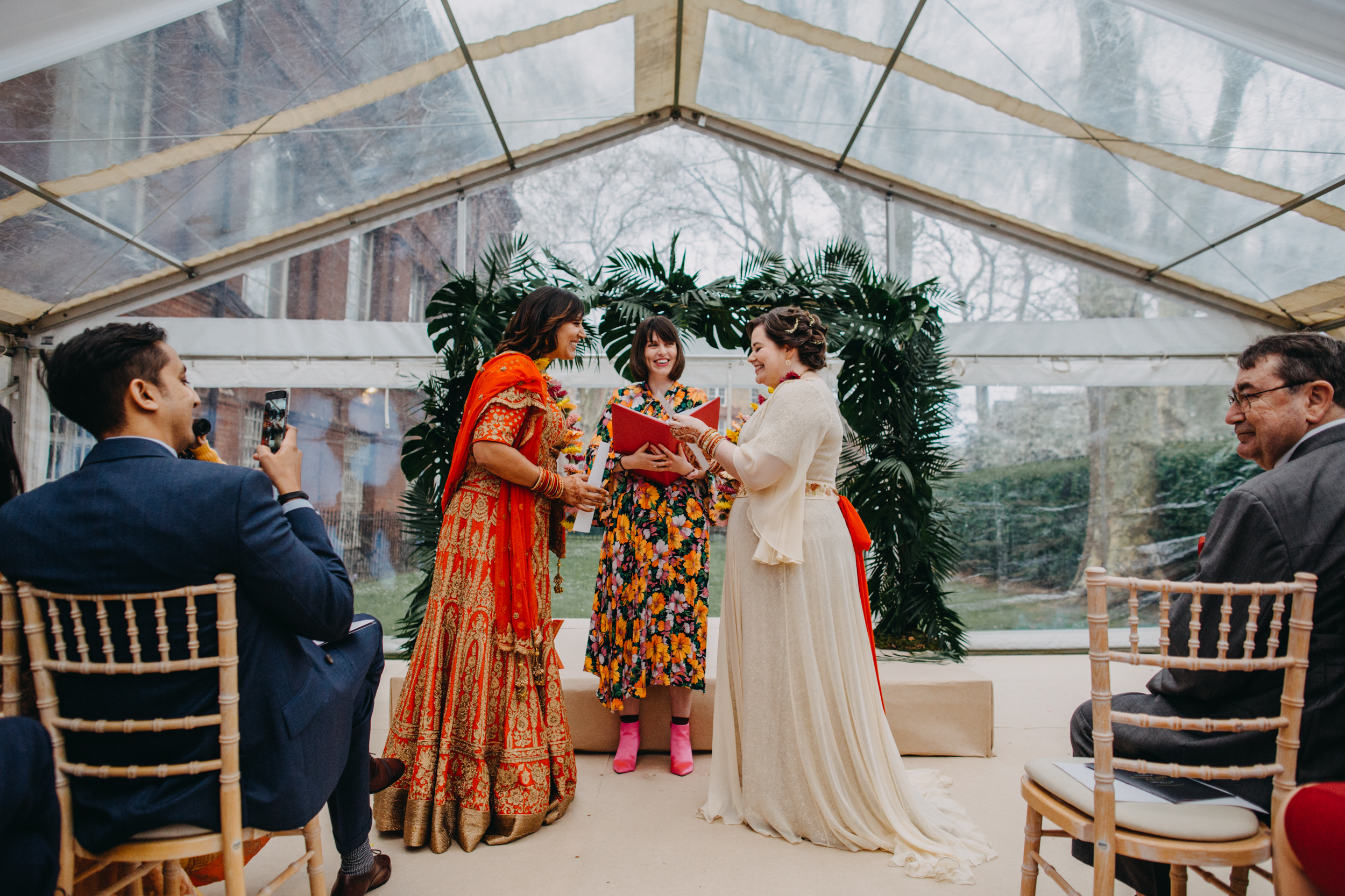 Kirsty and Reshma reading their surprise personal vows to each other during their Hindu-inspired Humanist wedding ceremony  Image by Lex Fleming