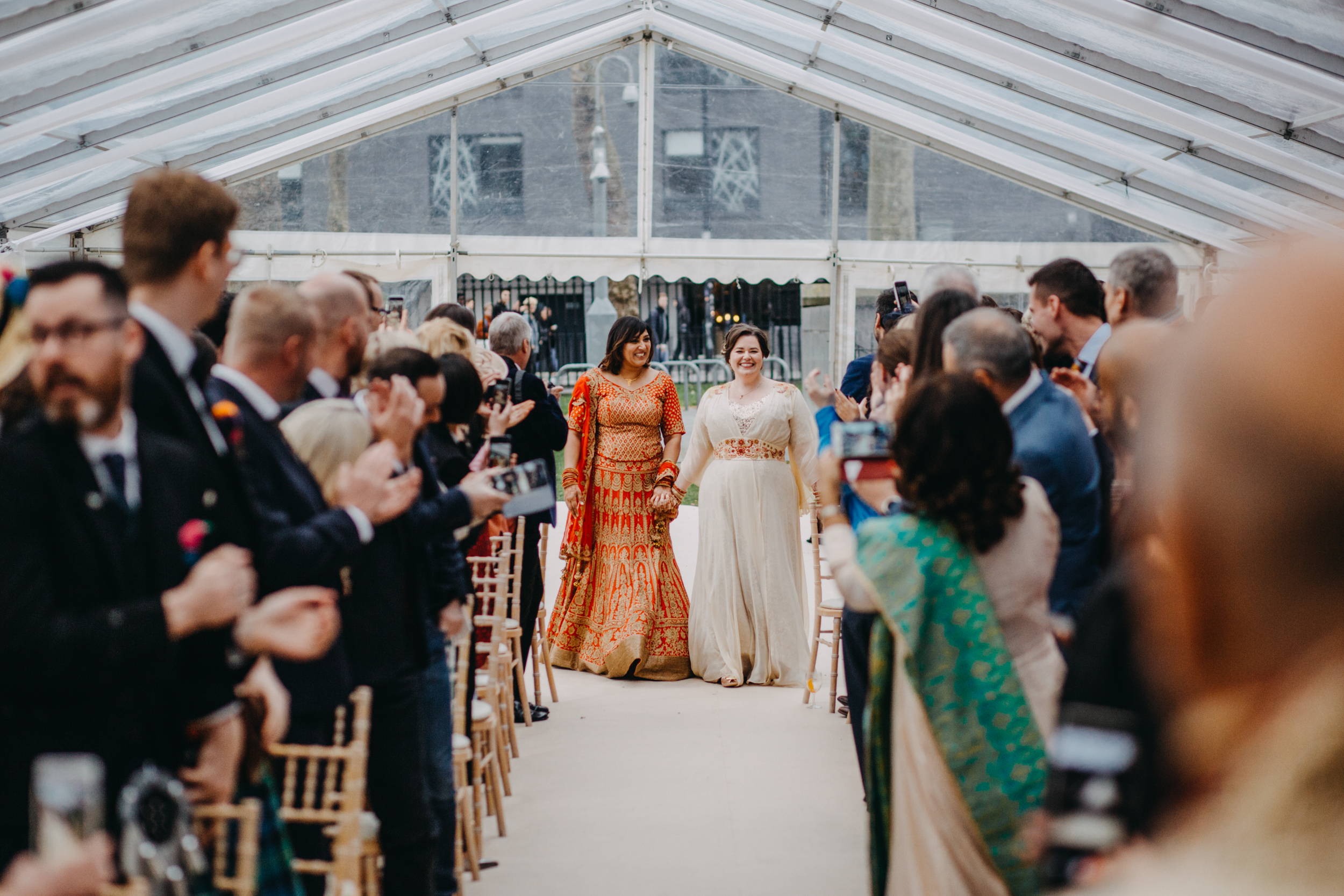 Kirsty and Reshma danced together up the aisle to Ru Paul Cover Girl. Amazing start to their ceremony!   Image by Lex Fleming