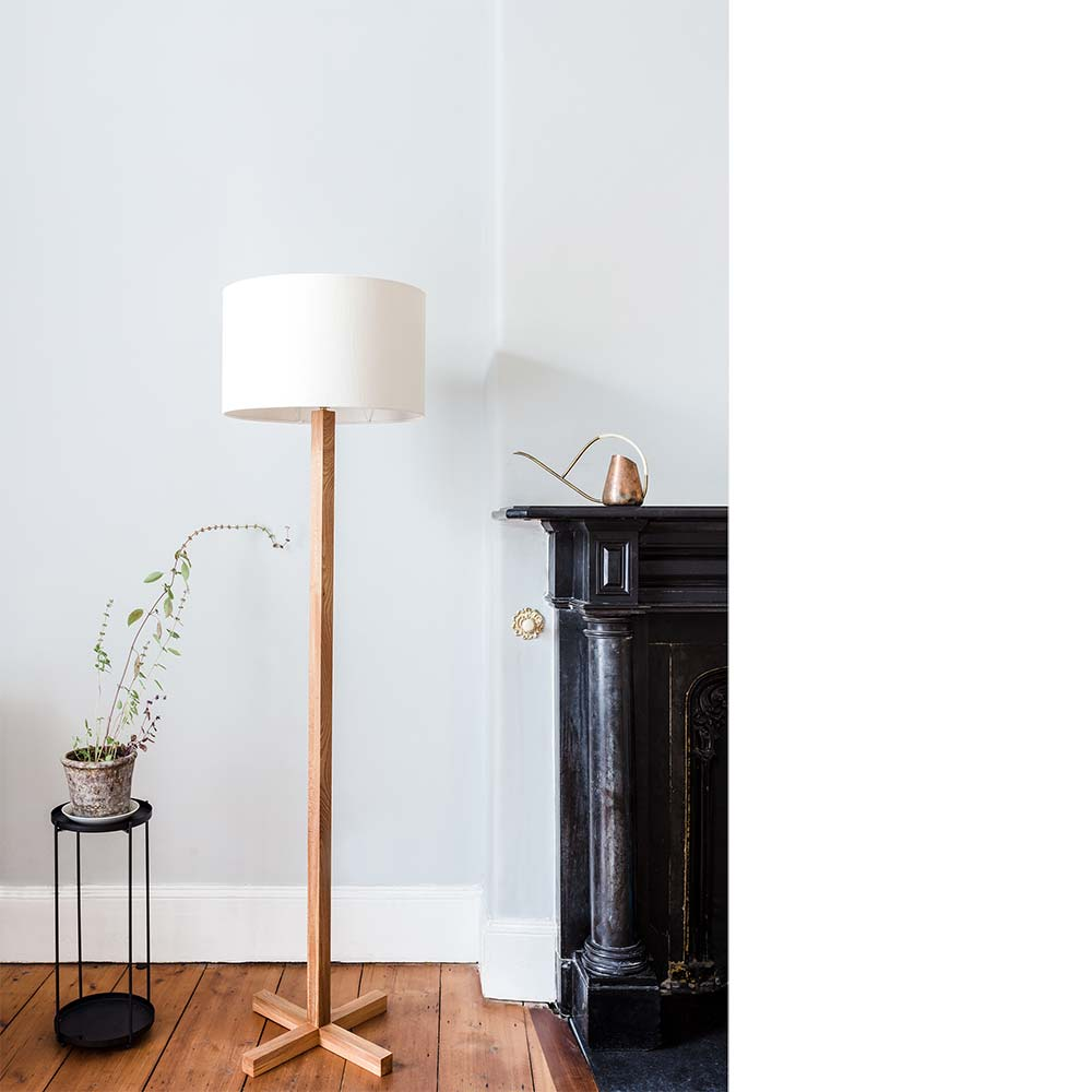 Concept - The noughts and crosses floor lamp is made from wild Irish elm. The circular 'nought' shade contrasts the base, which is drawn out to form a 'cross'. The cable is hidden in the interior of the lamp stand. A hardwearing, natural, hand rubbed oil finish is applied.