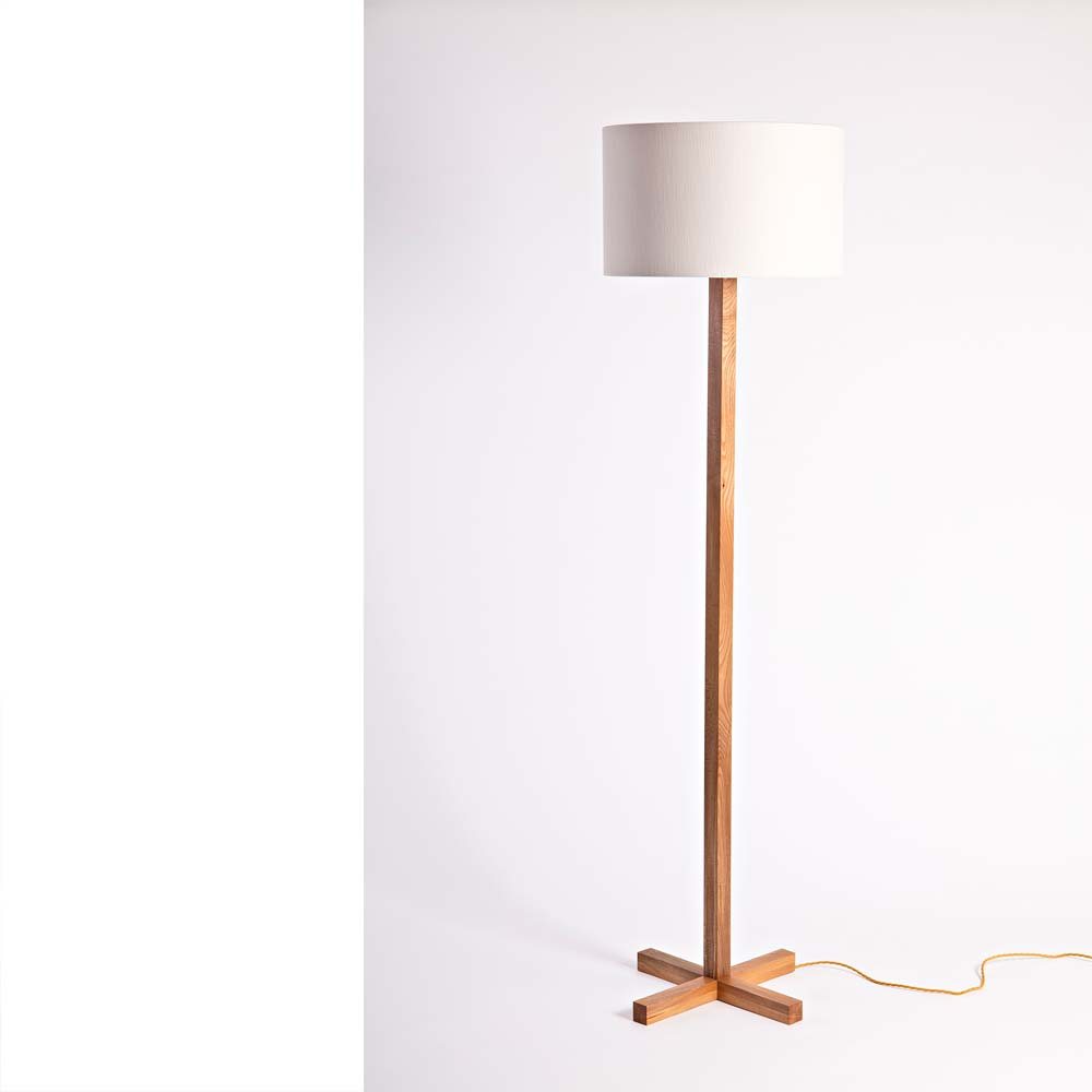 Materials & Details - The lamp can also be made in other woods such as wild Irish oak and ash. The shade is not provided enabling you to choose your own cylindrical shade.Dimensions: height 190cm, base 50cm, shade 50cm diameter by 30cm height.Please specify if you require a custom lamp height.Limited edition no. 3 now available.Price: €650