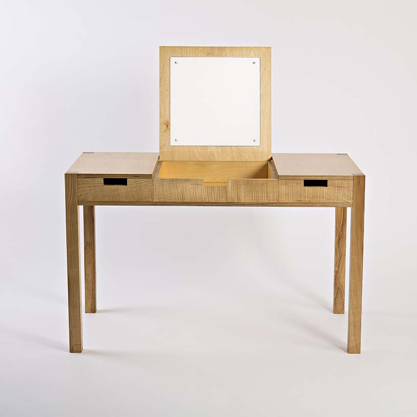 Materials - There are two drawers either side for storing the desk items. The drawer handles are simple rectangular cutouts.The desk dressing table is made from beautiful wild Irish ash and a high quality birch multiply. The finish is a hardwearing, natural, hand rubbed oil.