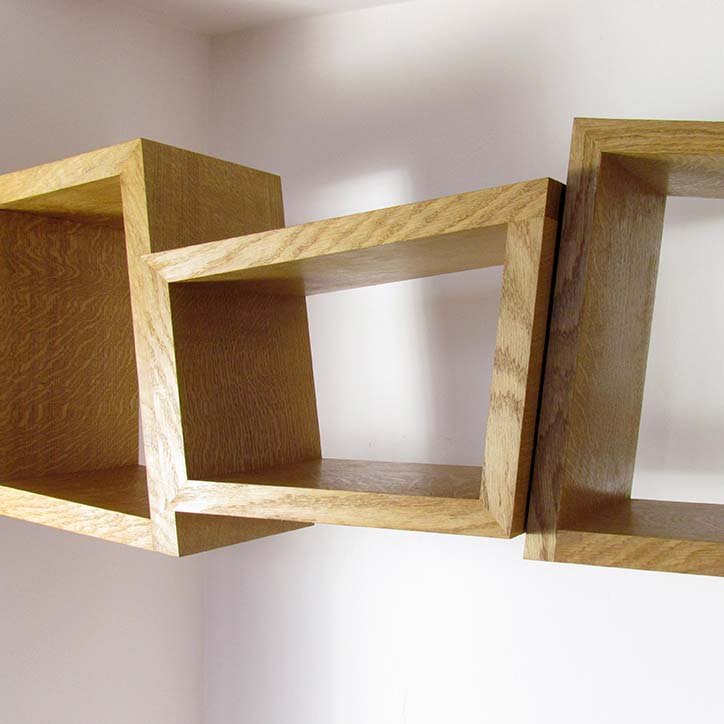 Concept - Inspired by shaped stones that simply rest and support each other to form the structure of a bridge, three shelves are individual shapes that support each other in spanning the alcove space. Made from wild Irish oak their independent shapes rest against and support each other as family might.