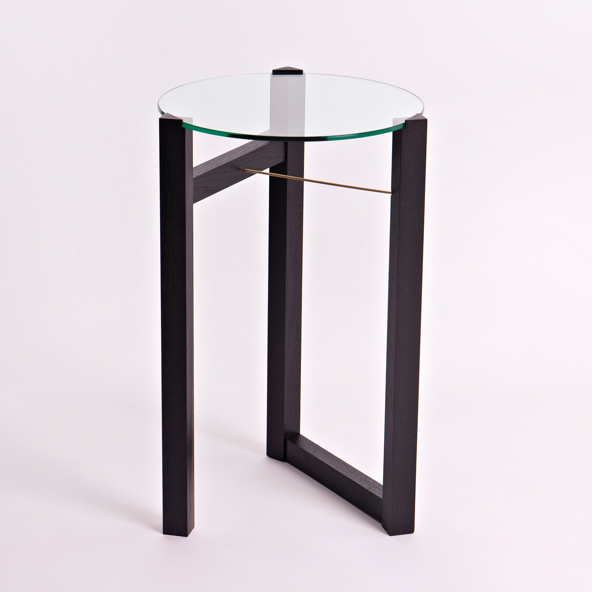 Materials - The table is handmade in beautiful ebonised European oak or wild Irish ash, with a solid brass rod to secure the glass to the top. The glass is toughened safety glass making it safe to handle.The sustainably sourced European oak is naturally ebonised using a vinegar and iron solution. The other option of wild Irish ash is sourced from Co. Wicklow. These trees are either windblown or have reached their end of life and need to be taken down. The table is finished with a hardwearing, natural, hand rubbed oil.