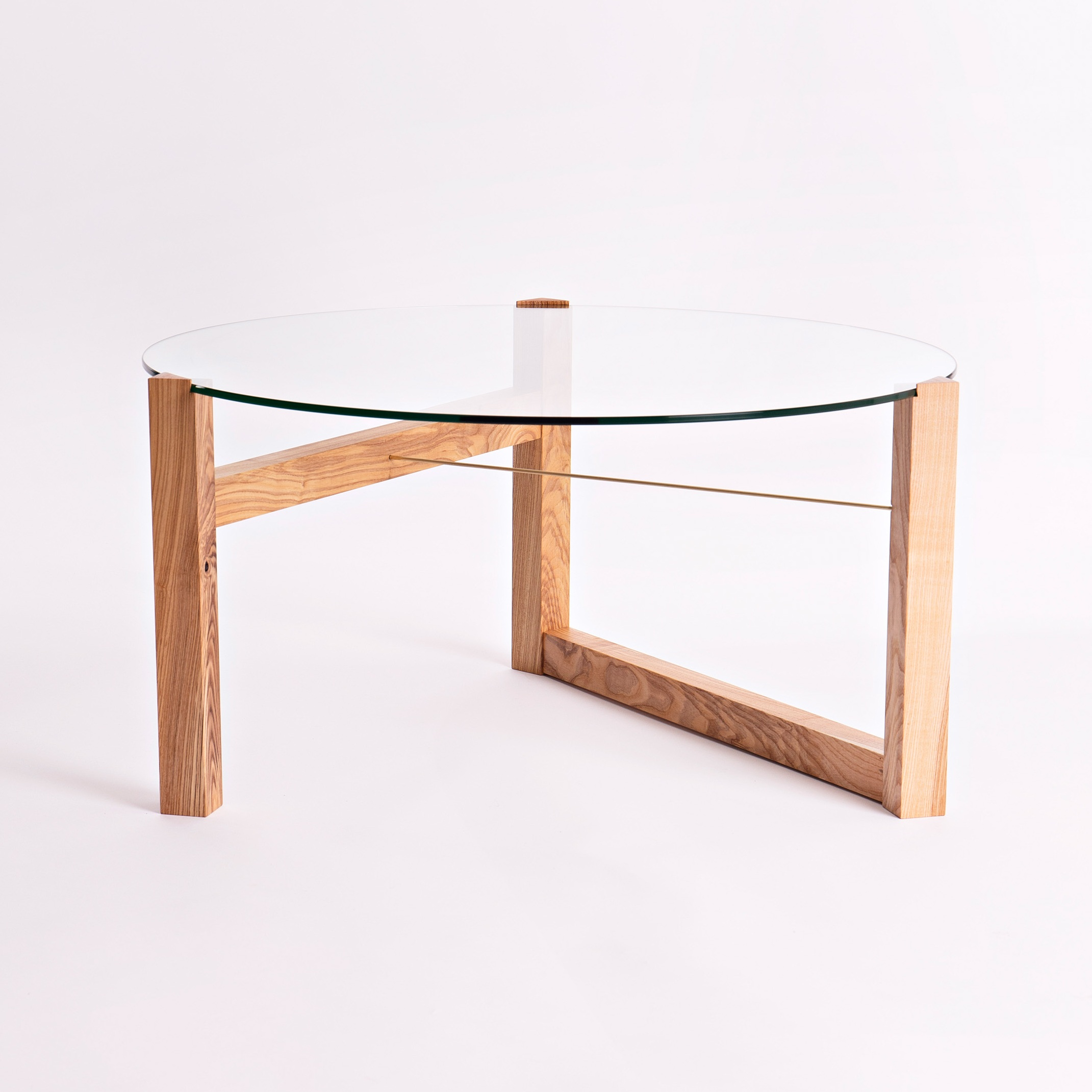 Materials - The table is handmade in beautiful wild Irish ash or ebonised European oak, with a solid brass rod to secure the glass to the top. The glass is toughened safety glass making it safe to handle. The table is finished with a hardwearing, natural, hand rubbed oil.The wild Irish ash trees are sourced from Co. Wicklow and are either windblown or have reached their end of life and need to be taken down. They are unmanaged