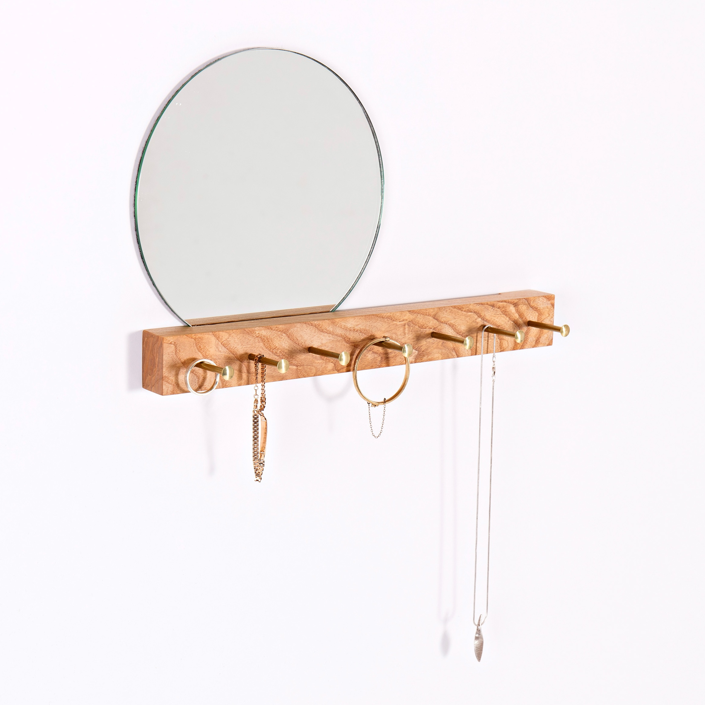 Concept - These simple, elegant hangers are perfect for organising jewellery or keys and cleverly combine with a mirror to check yourself on the way out the door.