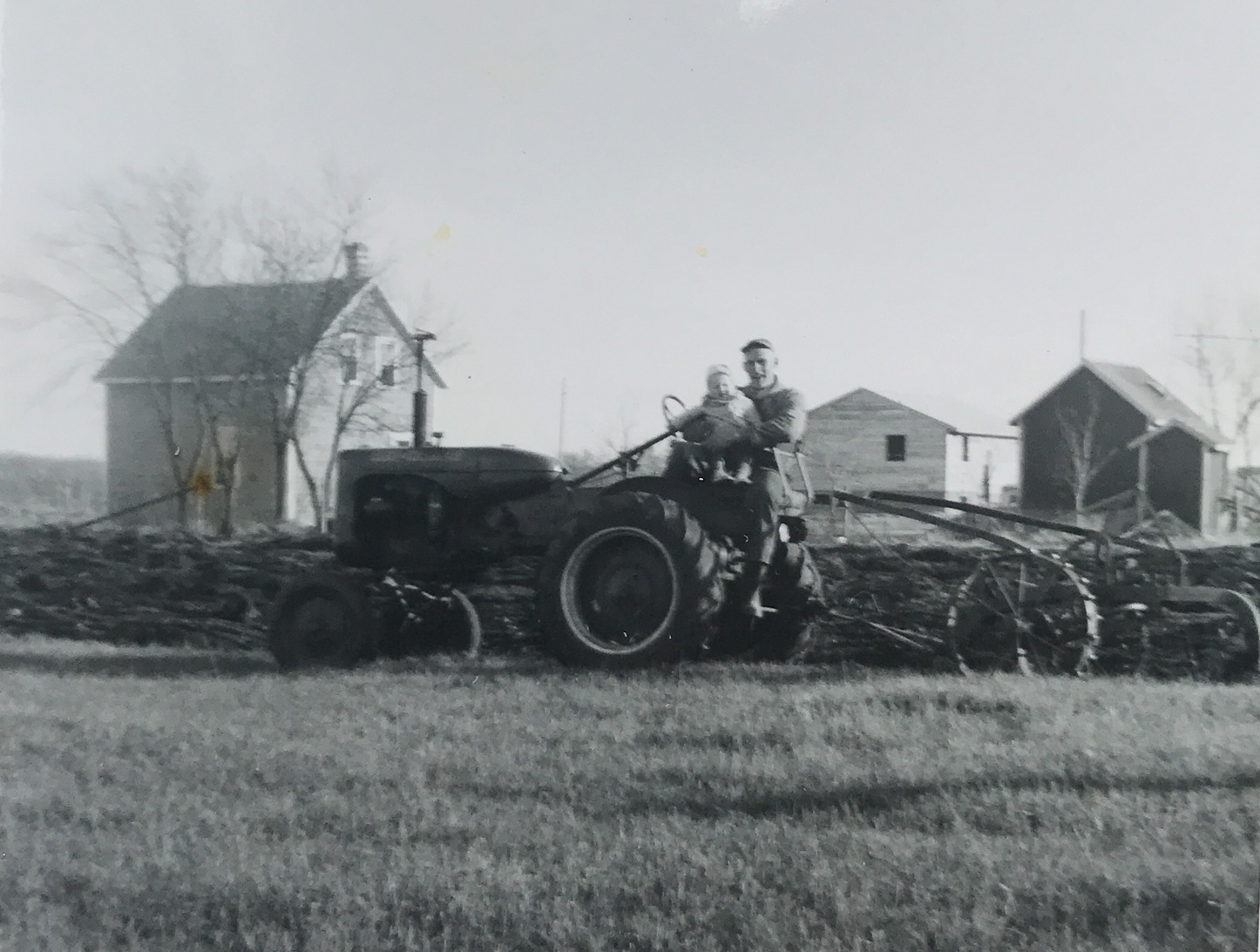 Louis with his daughter Diane on an Allis Chalmers B Tractor
