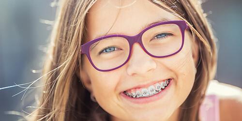 orthodontics-happy-young-girl-with-braces.jpg