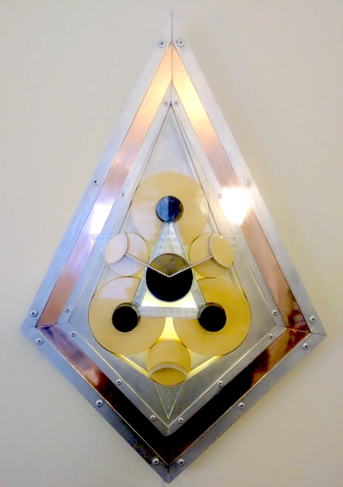 "Featured BAC Registered Work:   ""Trifecta V"" (2010)    18x24""    Mixed Media (copper, aluminum, birch, LED's, glass, granite)"