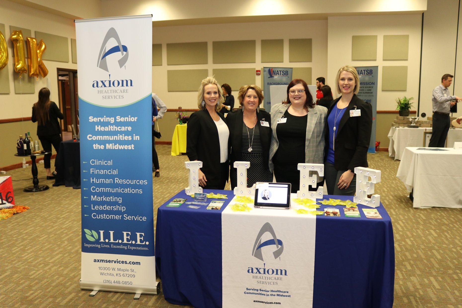 Axiom employees: Stephanie Wiens, Brenda Kruse, Dayna Hoock, and Madison Osoba.