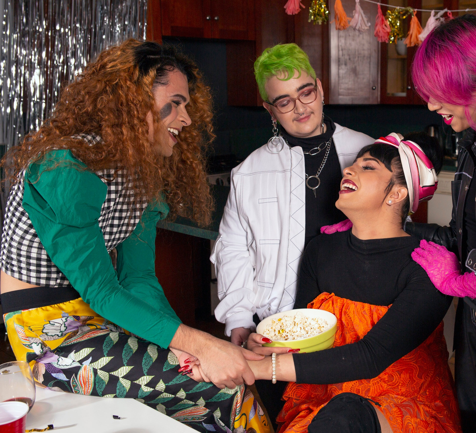 A group of friends of varying genders celebrating.jpg