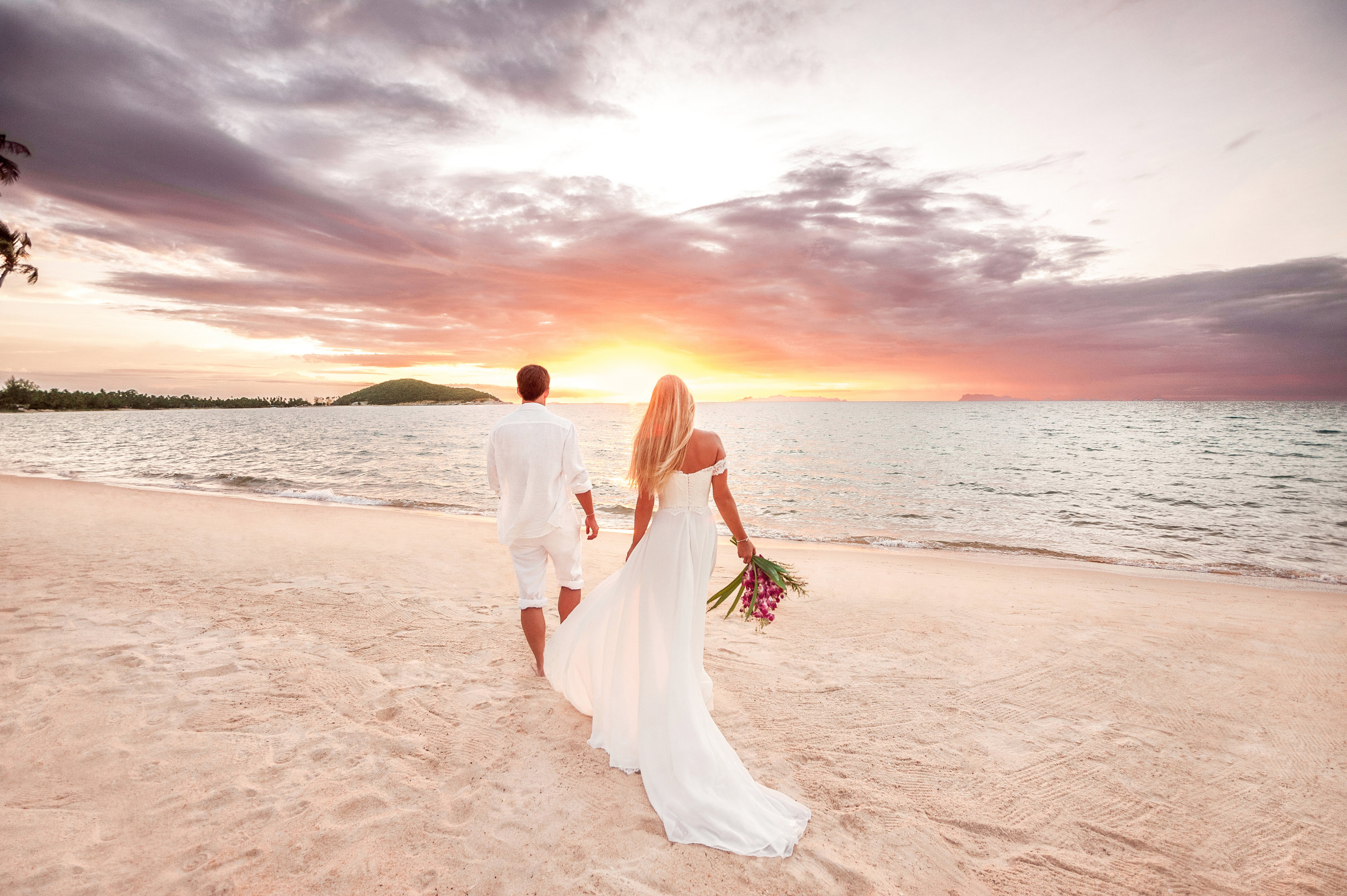 Bride and groom on a Hawaiian Beach.