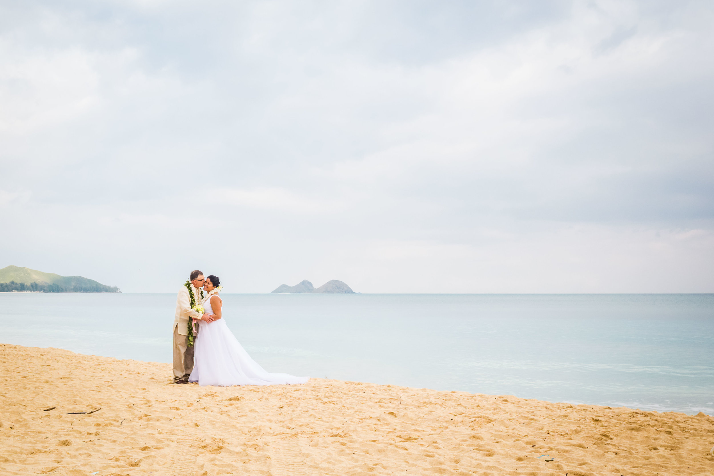 Bride and groom's post wedding bridal shoot on Hawaiian beach.